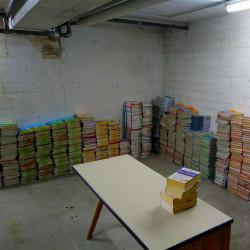 Stapel aussortierter Schulbücher